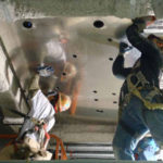 Installation of shielding material on ceiling in switchgear room.